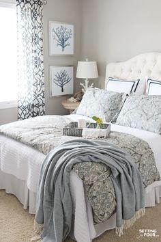Decorated light blue farmhouse bedroom decor. Part of our 50 DIY Farmhouse InteriorDecor Ideas!