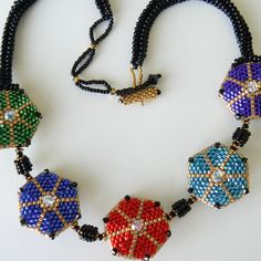 Firecracker necklace - Japanese delica beads, Swarovski crystals. Circular peyote, beaded beads and ndebele stitches.