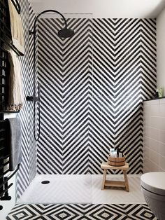 Maximalist Bathrooms That Feature Gorgeous Tile | From geometric shower tile ideas, to bright, colorful fun patterns and hues. These showers are glossy and beautiful pieces of bathroom inspiration.