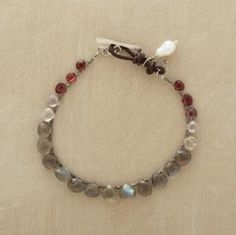 """DIVINE DROPLET BRACELET--Naomi Herndon showcases sparkling red spinel, labradorite and moonstone briolettes on oxidized sterling silver chain, adding a cultured keishi pearl to the leather loop and sterling silver toggle closure. Handcrafted exclusively for Sundance. 7-1/2""""L. by edmcfinn"""