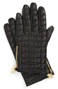 Kate Spade quilted black gloves.