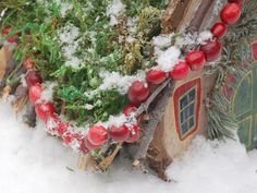 Hang your cranberry garland along the roof of your fairy house, just like Christmas lights. Use extra pieces of string to tie it on as you go.