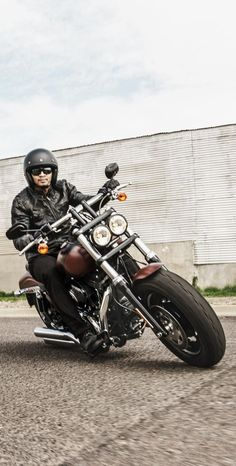 Blacked-out finishes. Dual bullet headlamps. This one raises a ruckus just rolling into town. | 2017 Harley-Davidson Fat Bob