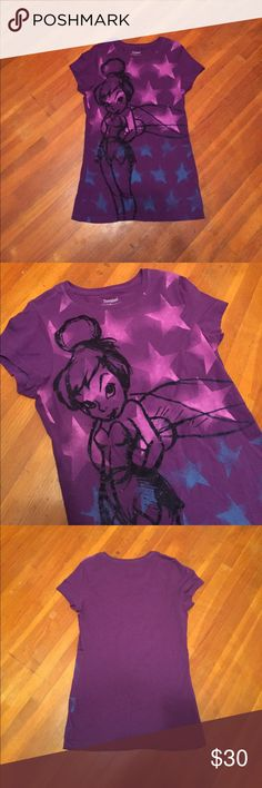 Tinker Bell Shirt Purple Tinker Bell shirt from Disney. Only worn once! The outline of Tinker Bell is felt that stands out among the rest of the shirt. 100% cotton Disney Tops Tees - Short Sleeve