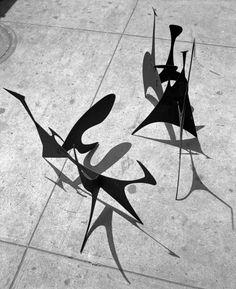 "ALEXANDER CALDER, Untitled and Spiny (c.1939), outside Calder's ""small shop"" New York City storefront studio, 1940. Material painted sheet metal. Photograph by Herbert Matter. / Calder"