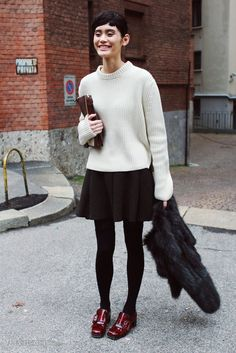 It's a simple and effortless outfit, but feminine; a deviation from the oft-seen off-duty model uniform of skinny jeans and boots. Ming Xi was spotted comp Burgundy Shoes, White Burgundy, Black White, Ming Xi, Red Loafers, Black Skater Skirts, Silhouette, Skirt Fashion, Fashion Fashion