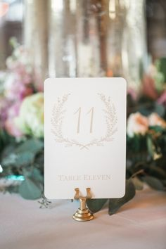 Elegant white + gold table number idea - white card with table numbers in gold font {Sasha Bohème Photography}