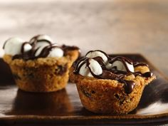 Caramel S'more Cups  w/Betty Crocker Chocolate chip cookie mix, Rolo, mini marshmallows and chocolate chips.  Love individual finger-food desserts