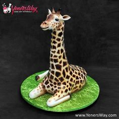3D Giraffe Cake 3D Elephant Cake The tusks are made of pastillage.  Learn cake decorating online at http://www.yenersway.com