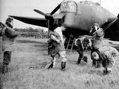 The crew of a Whitley bomber preparing for an operation. The Whitley was the backbone of RAF Bomber Command until more modern four engined bombers came into service.1941