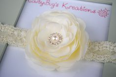 Kaitlyn Collection: ivory ranunculus flower on stretch lace. $8.95, via Etsy.