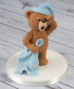 Meet Jake, one of our new Renshaw Ready to Roll Icing bears. Jake has been decorated to give a smooth fur effect to the icing. Meet Jake, one of our new Renshaw Ready to Roll Icing bears. Jake has been decorated to give a smooth fur effect to the icing. Fondant Cake Toppers, Fondant Cakes, Cupcake Cakes, Cupcake Toppers, Fondant Icing, Car Cakes, Chocolate Fondant, Modeling Chocolate, Mini Cakes