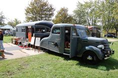 Unusual old camping trailer and maybe a customized old International truck tow vehicle.