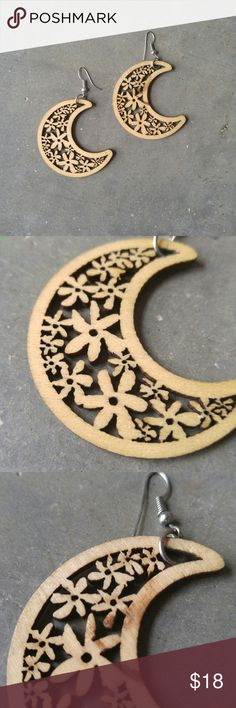 Crescent Moon Shaped Floral Lasercut Wood Earrings Wood earrings in excellent condition! Very lightweight. Crescent moon shaped with flower cutouts. Dark spot on one side of one earring. Silver metal fish hooks. No brand. Please ask any questions. No trades. Make a reasonable offer. Thanks! Boutique Jewelry Earrings