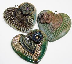 Assorted Raku Heart Pendants by Lisa Peters Art, via Flickr