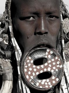 Mursi Woman. Omo valley. Ethiopia   - Explore the World with Travel Nerd Nici, one Country at a Time. http://TravelNerdNici.com