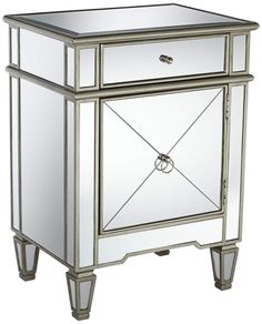 Can't go wrong with mirrored pieces!  Here's to hoping I can upgrade my wimpy mirrored nightstands to something closer to this :)
