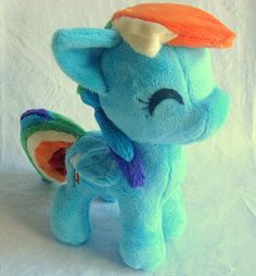 "Itty Bitty Dashie is perfect for the MLP fan who can't afford a large plush, doesn't have the space for one, or just goes ""awwwwwww!"" at small fuzzy things! She stands 8"" tall- just big enough to still be snuggly, but small enough to fit in your bag or on your desk. She's made entirely from s..."