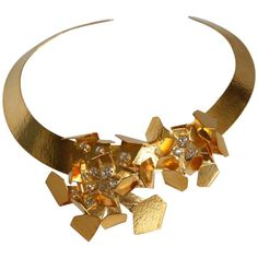 Herve van der Straeten Gilded Brass Crystal Floral Motif Torque Necklace | From a unique collection of vintage choker necklaces at https://www.1stdibs.com/jewelry/necklaces/choker-necklaces/
