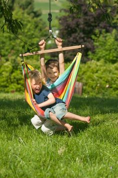 Rainbow Hammock Chair Swing can be hung indoors or out. Made from 100% heavyweight cotton and sustainable bamboo. $69.95