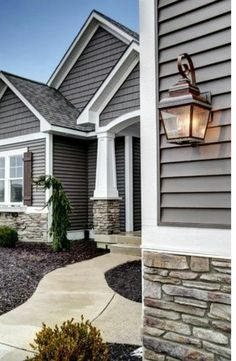 Check out the White columns, they match the trim & gray siding & black roof.