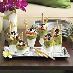 Mini Caviar Parfaits: To pull this sophisticated dish together fast, purchase peeled, boiled eggs in the deli or dairy section of your grocery store. Use leftover caviar and purchased boiled eggs to make extra-special deviled eggs.  25 Show-Stopping Appetizers | Mini Caviar Parfaits | SouthernLiving.com