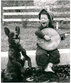singing, banjo and dog