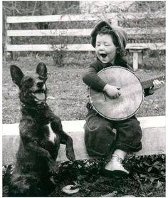 singing, banjo and dog