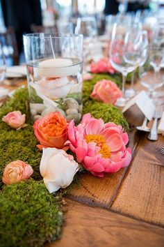 Organic centerpieces made with peonies and moss / http://www.deerpearlflowers.com/moss-decor-ideas-for-a-nature-wedding/2/