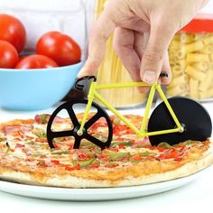 Cut those perfect pizza slices by riding this bicycle over it. This Bicycle Pizza Cutter is here to add some fun to your pizza slicing hours. The cutter comes with dual stainless steel blades and is one of the best ways you can ensure to have your pizza d Design Shop, Cool Kitchen Gadgets, Cool Kitchens, Plain Pizza, New Pizza, Pizza Food, Love Pizza, Pizza Pizza, Pizza Dough