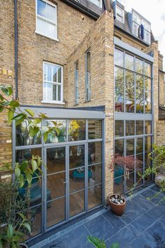 Double height crittall style glazed extension with a single spine bespoke staircase.  www.hollandgreen.co.uk