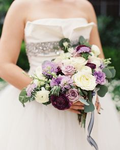 Bristol Lane used garden roses, lisianthus, scabiosa, ranunculus, and larkspur to create a purple and ivory look. Purple Wedding Bouquets, Rose Wedding Bouquet, Bride Bouquets, Rose Bouquet, Flower Bouquets, Bridesmaid Bouquets, Winter Bridal Bouquets, Winter Bouquet, Eucalyptus Wedding