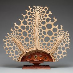 "Mark Henry Doolittle Wood Sculpture, Symbiosis"", Amboyna burl and Basswood with Bubinga base."