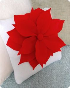 Decorate your home with Poinsettia Pillows! Use felt for the petals and a pillow form to create this free Christmas craft. Sit back and relax this season. All Things Christmas, Christmas Holidays, Christmas Decorations, Christmas Ornaments, Holiday Decorating, Christmas Poinsettia, Christmas Sewing, Christmas Pillow, Flower Pillow
