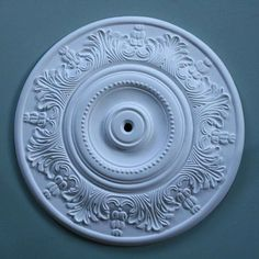 An understated Victorian plaster ceiling rose featuring acanthus leaves on the outer border with a plainly moulded centre, this is a best seller.