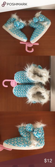 **NWT** Fuzzy Slippers New with tags. Fuzzy indoor slippers. Soft and cozy. Size 9/10 Shoes Slippers