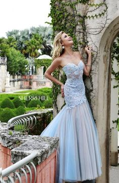 SHERRI HILL Prom Dresses 2015 # 11155 A semi-sweetheart fitted bodice and the softest pastel shades of layered tulle make this bustier style mermaid gown truly unforgettable.