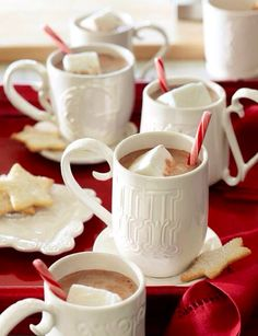 Christmas Entertaining with mugs of hot chocolate. This will make you think of ice skating!