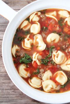 Italian Sausage Tortellini Soup Recipe on twopeasandtheirpo... Love this simple and hearty soup!    Made this for the family last week and the kids went gonzo!