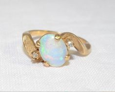 Dainty Vintage Opal 14k Yellow Gold Oval Ring by LadyLibertyGold