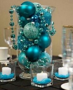 Turquoise Christmas bulbs in a vase as table decor. 50 Most Beautiful Christmas Table Decorations Beautiful Christmas, Simple Christmas, Christmas Holidays, Christmas Bulbs, Christmas Crafts, Christmas Mantles, Homemade Christmas, Winter Wedding Centerpieces, Simple Centerpieces