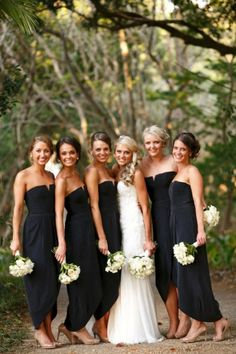 Bridesmaids in black with nude shoe. Bride wears Suzanne Harward haute couture gown. Follow @Suzanne, with a Z Harward on Instagram. Image by Blumenthal Photography