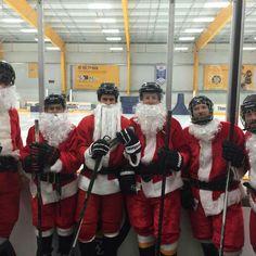 Hockey playing military Santa's