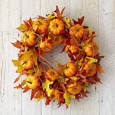 "Easy to replicate wreath w/ leaf garlands and faux pumpkins.  This version is 17"", $109.95!  Maple Leaf Pumpkin Wreath"