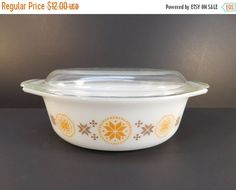Vintage Pyrex Town & Country Casserole Dish  Measures 10 1/4 inches from handle to handle, 6 7/8 inc
