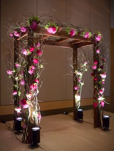 wooden trellis with curly willow and peonies