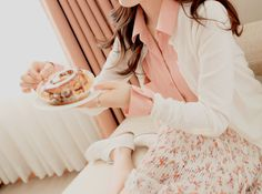 Kfashion Very cute with the pastel top with a cute floral skirt.