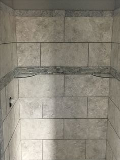 Shower for Northwest Development. Designed by Josh Meeker of RB's Flooring & Care.  Tile American Tile 12x24 Piedra Color Marfil  Linear Band Emser 12x12 Travertino Royal Color Silver  Boarder 3x6 Tumbled Stone Color Silver