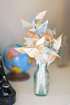 map pinwheels and other map crafts Map Crafts, Diy And Crafts, Plate Crafts, Non Floral Centerpieces, Pinwheel Centerpiece, Car Centerpieces, Pinwheel Cake, Centerpiece Ideas, Vintage Wedding Favors