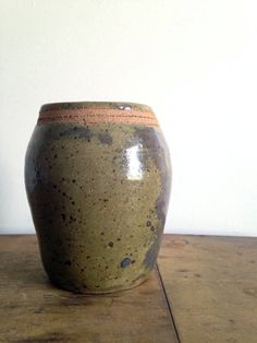 A beautiful stoneware pottery vase or pot with a perfect green and grey speckled…